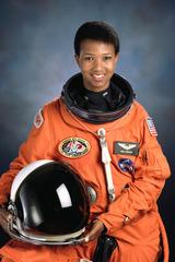 Official portrait of STS-47 Mission Specialist Mae C. Jemison, wearing her astronaut spacesuit.